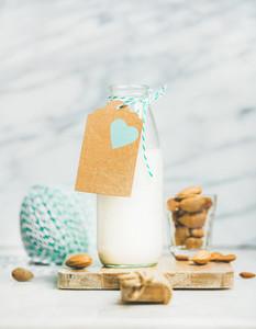 Fresh vegan dairy free almond milk with craft paper label