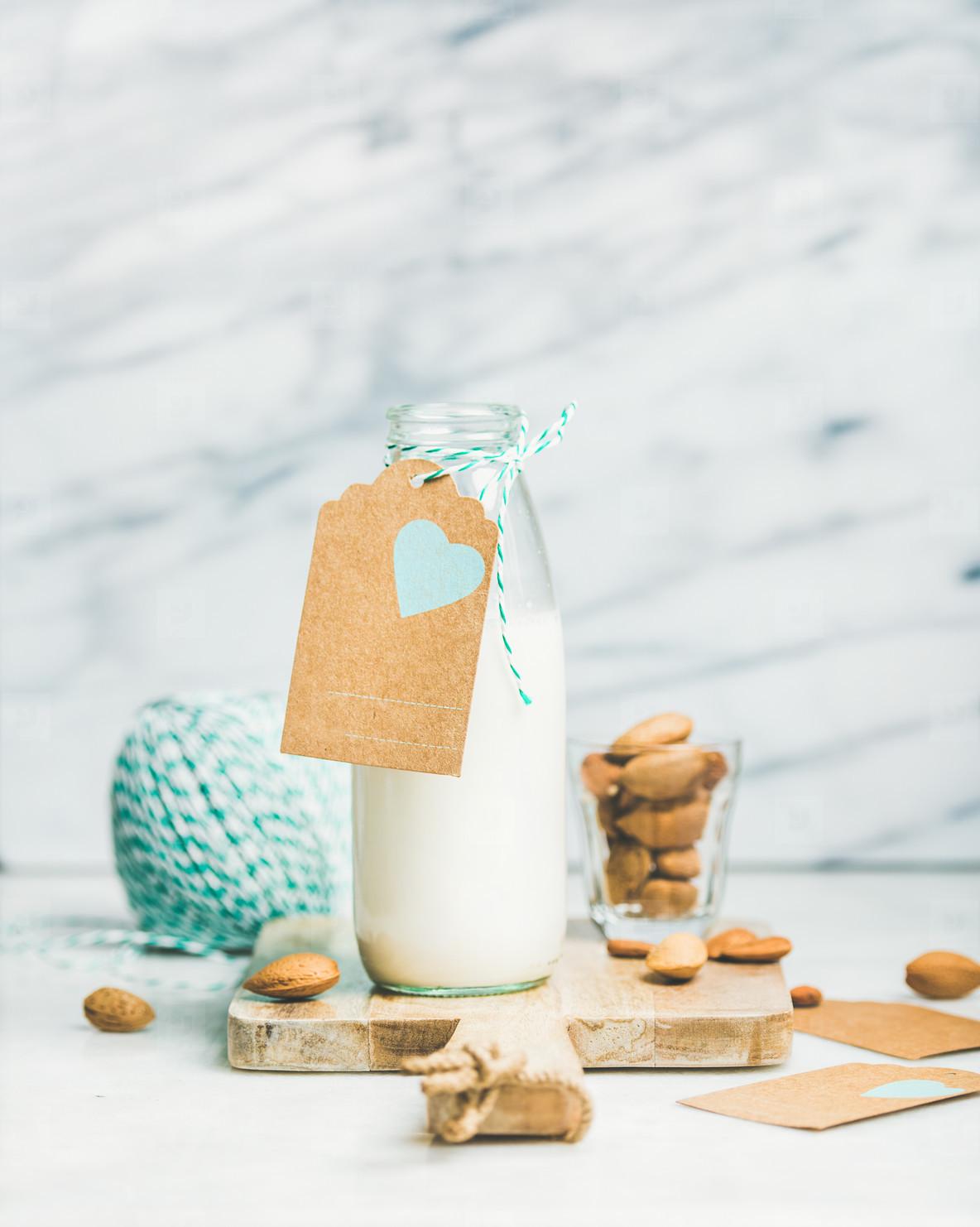 Fresh vegetarian dairy free almond milk with craft paper label