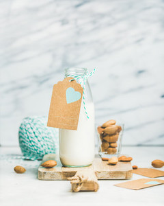 Fresh vegetarian dairy free almond milk with craft paper label