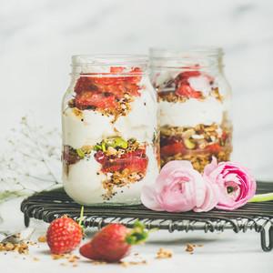 Healthy spring breakfast with pink raninkulus flowers  square crop