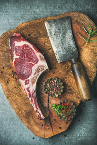 Dry aged raw beef rib eye steak with spices