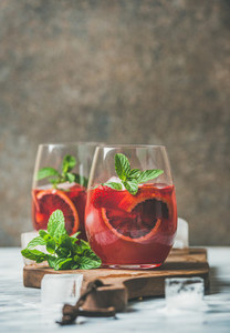 Blood orange and strawberry summer Sangria in glasses copy space