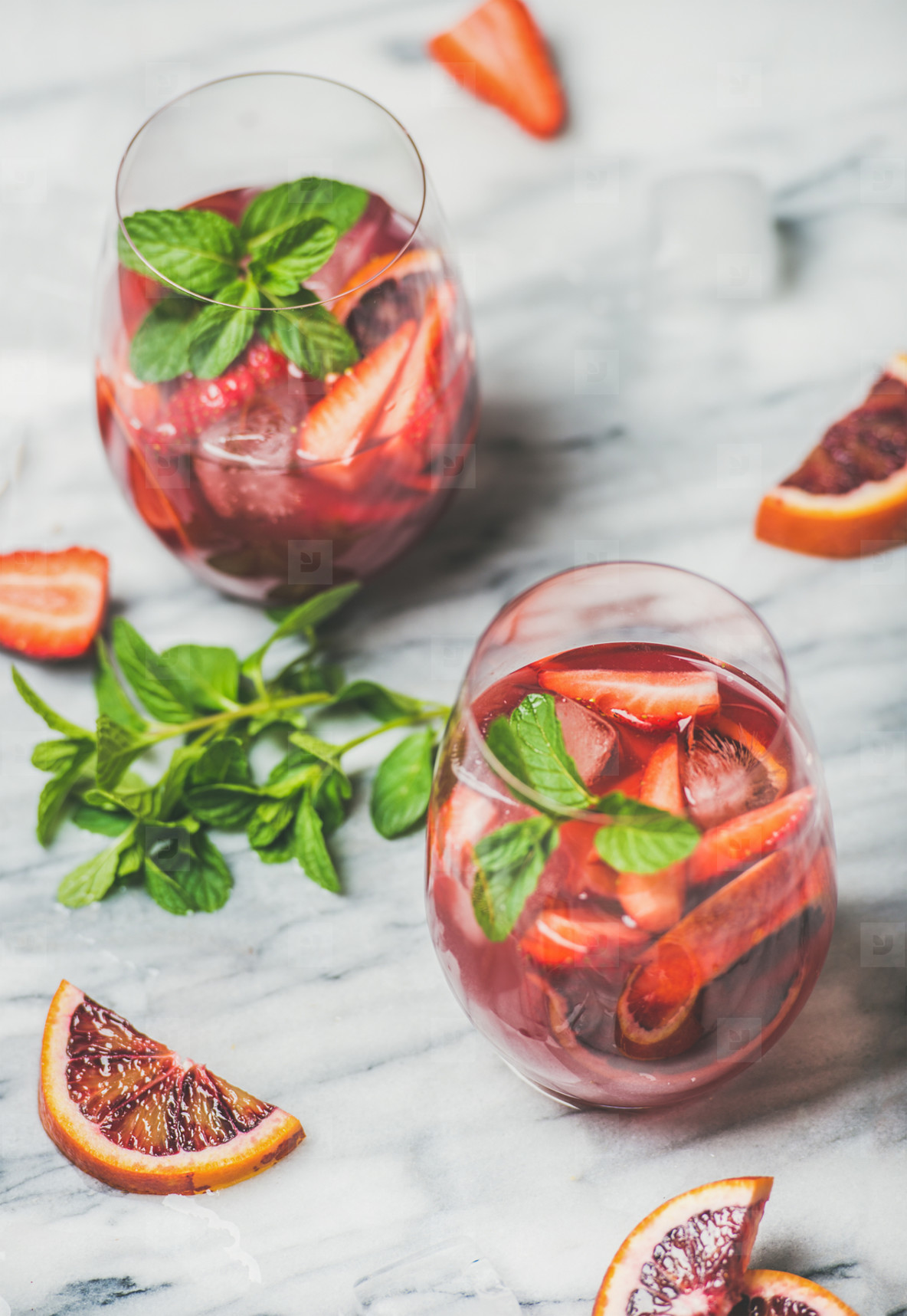 Fruit refreshing Sangria cocktails in glasses with ice and mint