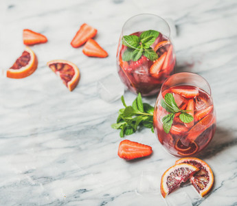 Fruit refreshing Sangria cocktails with ice and fresh mint
