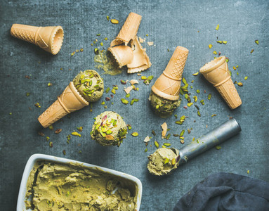 Homemade pistachio ice creamwith nuts over grey background
