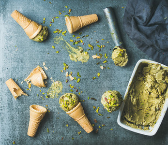 Homemade pistachio ice creamwith nuts over grey background  copy space
