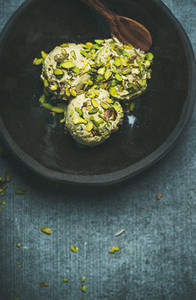 Homemade pistachio ice cream with crashed nuts in bowl