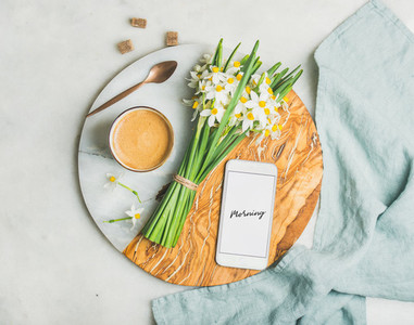 Coffee bucket of flowers and mobile phone with Morning word