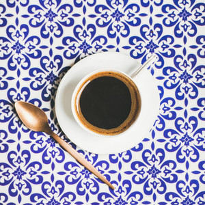Cup of black Turkish or Eastern style coffee  square crop