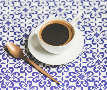 Cup of black Turkish or Eastern style coffee  oriental background