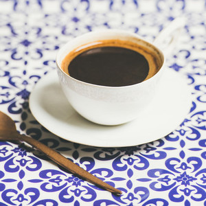 Cup of black Turkish or Eastern style coffee selective focus