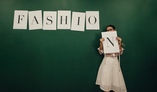Confident young female designer in studio