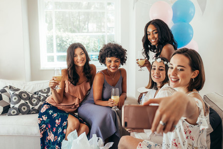 Women friends making selfie at baby shower