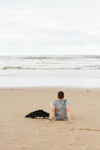 Young man resting in a beach