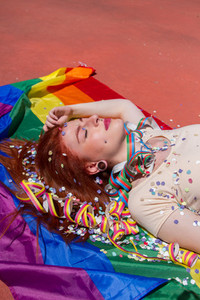 Young woman and rainbow flag