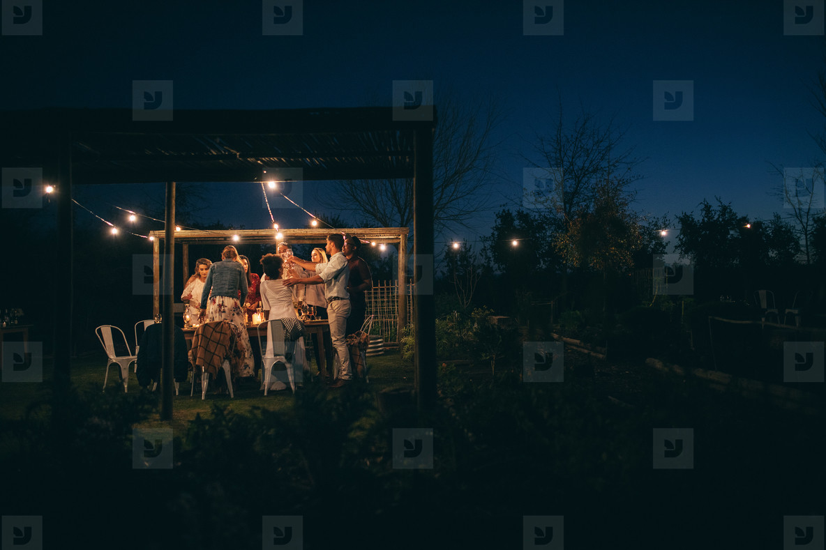 Group of people having a party at night