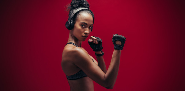Strong woman standing in fighting stance