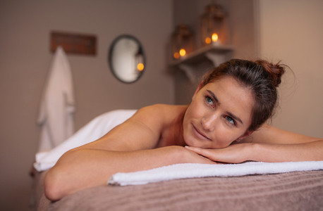 Beautiful woman lying on a massage table and relaxing