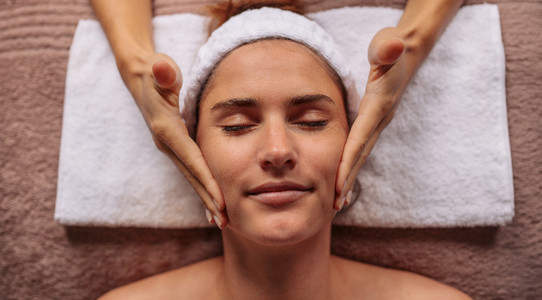 Female getting facial message treatment beauty salon