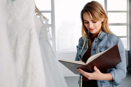 Female entrepreneur in bridal clothing store