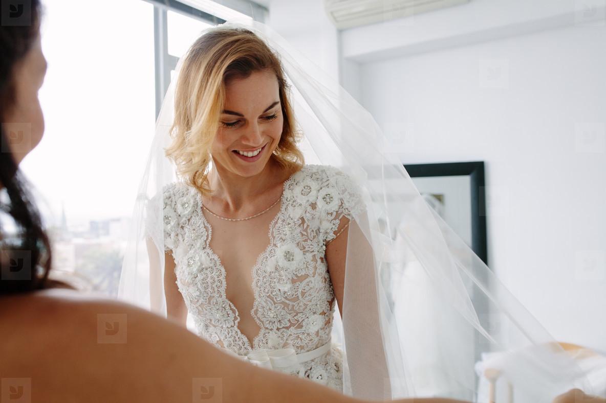Attractive future bride fitting new dress