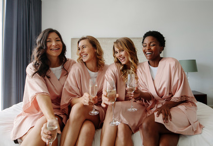 Bride and bridesmaids celebrating hen party