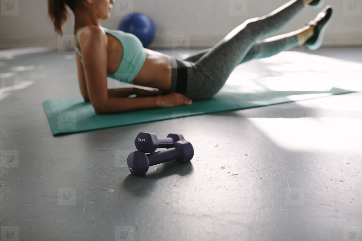 Woman doing stretching workout at health club