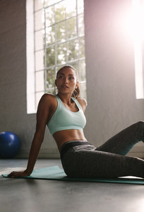 Woman resting after workouts at gym