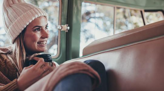 Woman on roadtrip travelling by van
