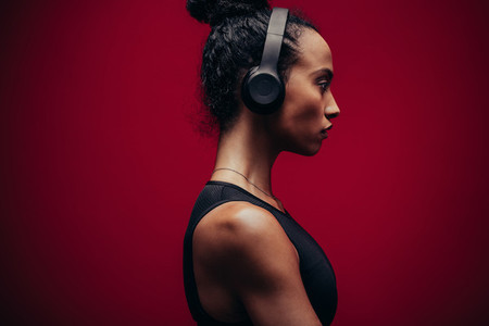 Fitness woman in sportswear and headphones