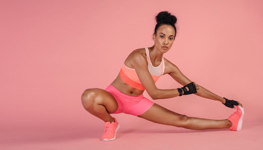 Healthy woman doing stretching exercises in studio