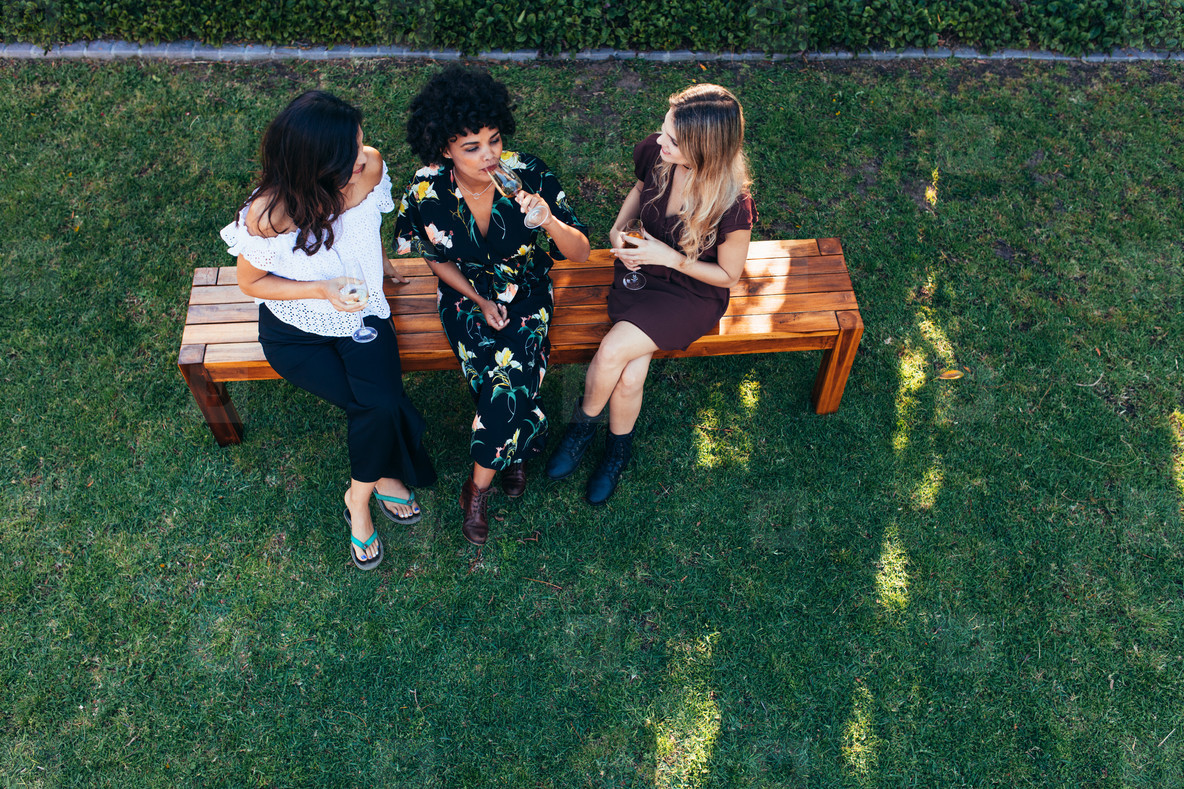 Women hanging out with drinks outdoors