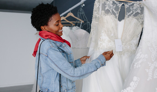 Woman shopping for wedding outfit in bridal boutique
