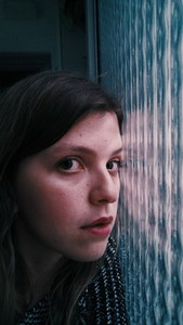 Moody portrait with a window