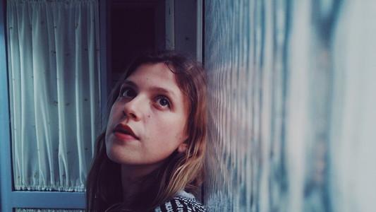 Moody portrait with a window