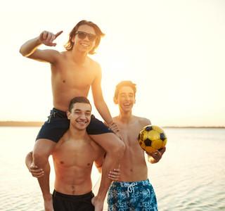 Laughing happy multiethnic teenage boys