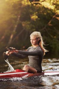 Athletic woman kayaking