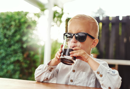 Stylish little boy wearing trendy sunglasses