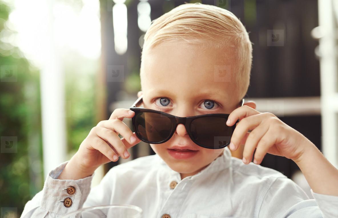 Handsome little boy in trendy sunglasses