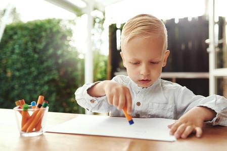 Creative little boy doing art