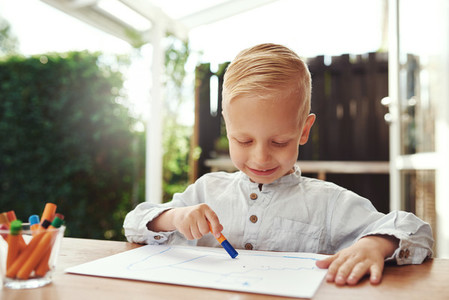 Smiling happy little boy expressing his creativity