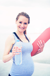 Fit young woman exercising during pregnancy