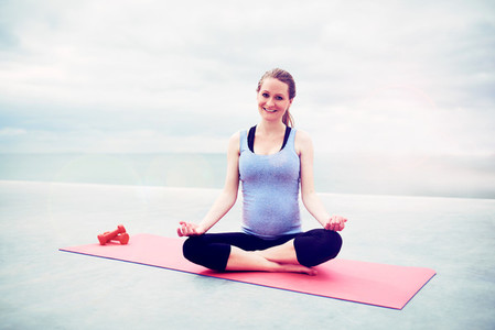 Pregnant woman sitting meditating