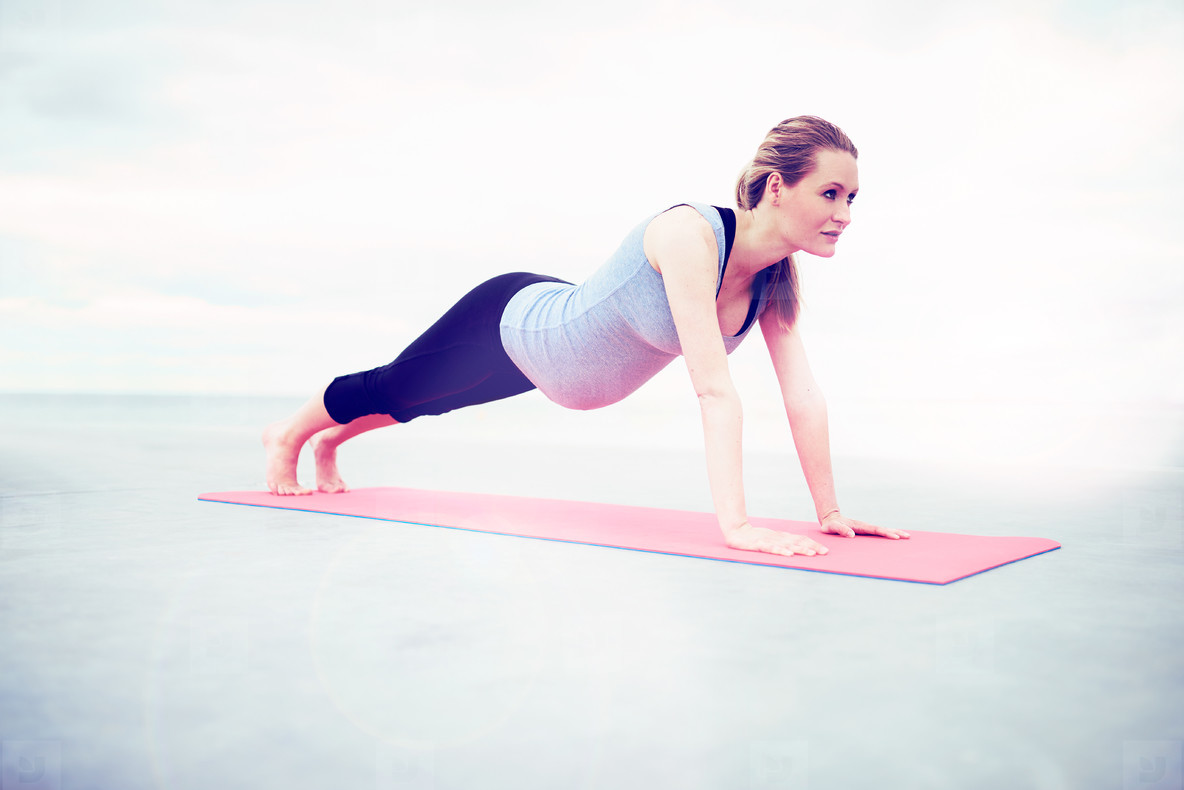 Woman doing press ups during her pregnancy