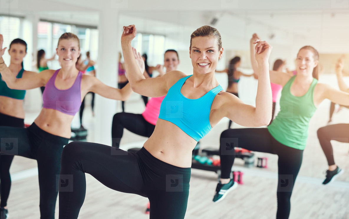 Group of young women practicing aerobics