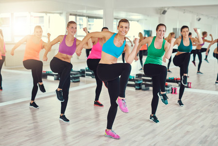 Group of fit young women doing exercise together