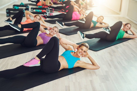Group of fit healthy young women in a gym