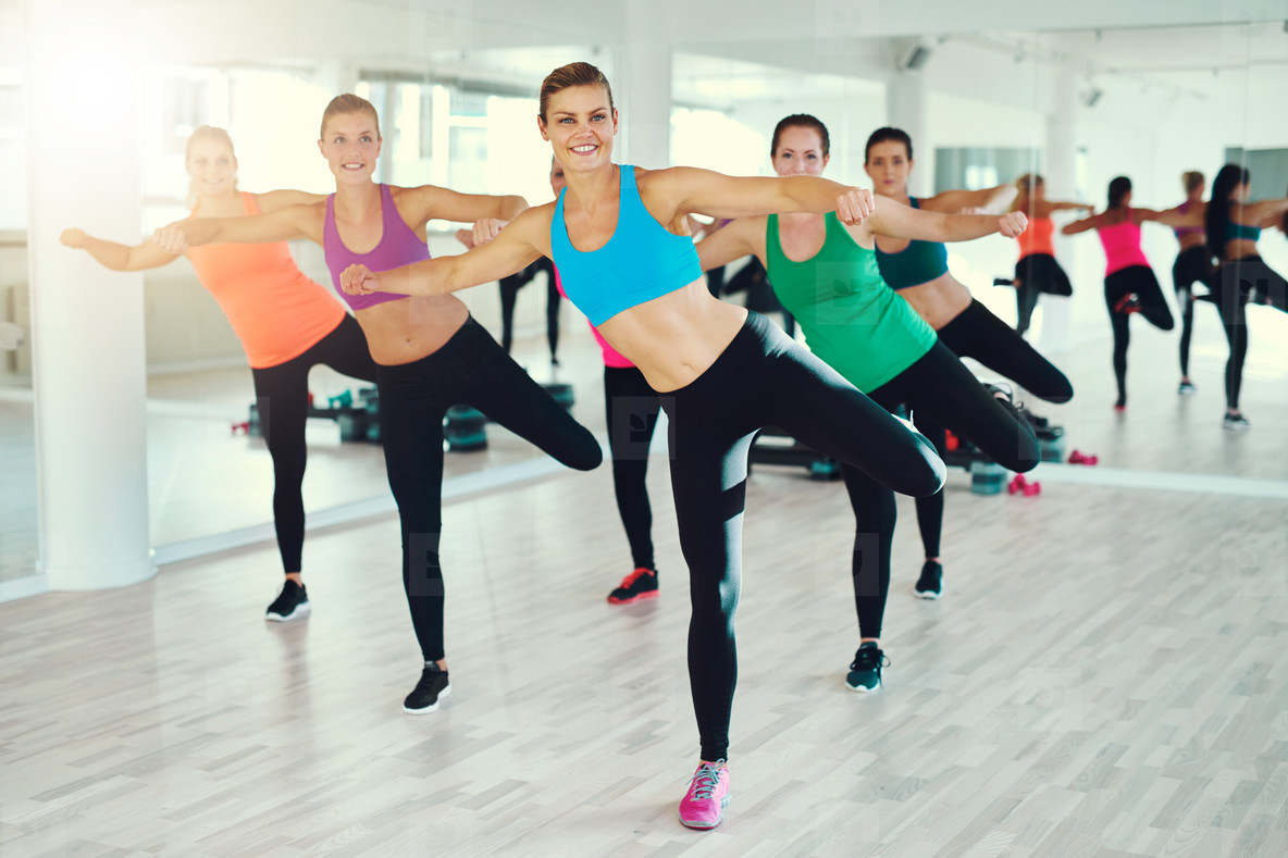 Young women exercising synchronously