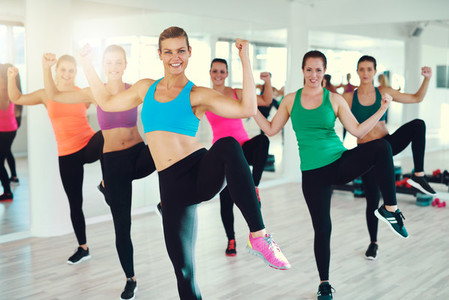 Active young women doing exercise together