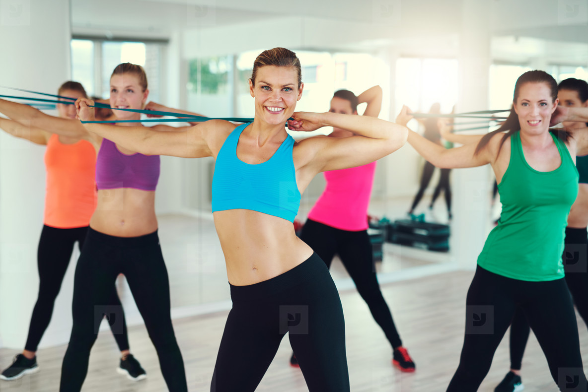 Group of young women stretching arms